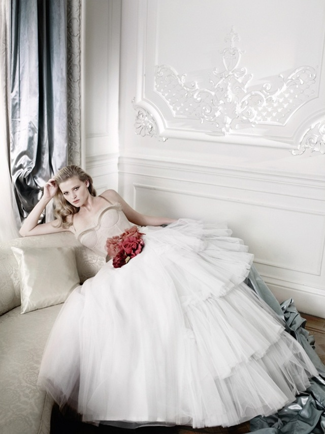 Model Lara Stone, by Mario testino, with a white long dress.