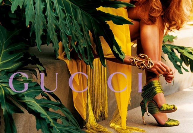 A Gucci ad campaign by Mario Testino, with the detail of a model tying the sandal surrounded by green details and verdure