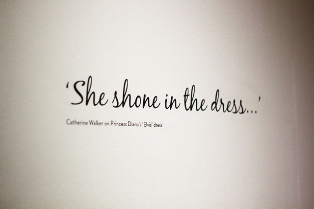 """A quote in the wall of the museum saying """"She shone in the dress..."""""""