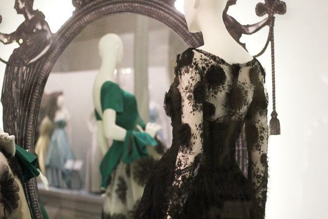 A shot inside the exhibition, with two gowns on display