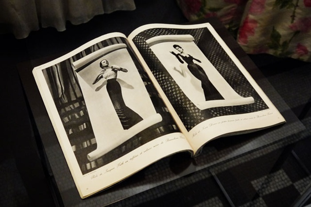 A shot inside the exhibition to the pages of a book with models from the 50s