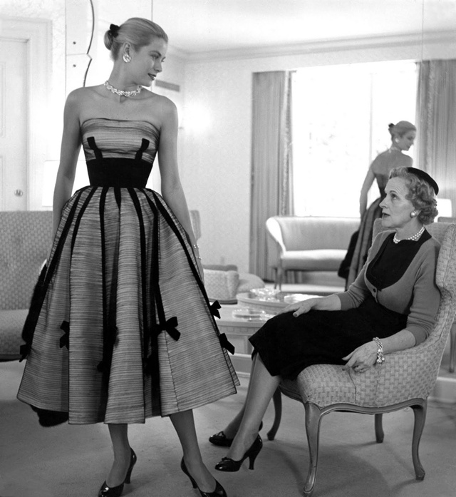 A picture in black and white of Grace Kelly with a gown