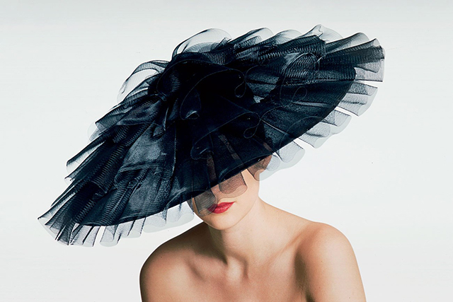 The elegance of a hat in a naked body.
