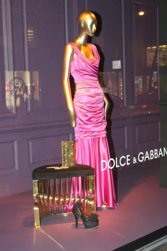 Mandy stool by KOKET at Saks Fifth Avenue NY windows.  KOKET furniture at Saks Fifth Avenue Saks Fifth Avenue window displays Koket and Dolce Gabbana fuchsia dress