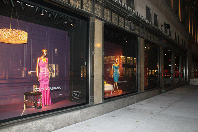 Saks Fifth Avenue window displays with KOKET furniture and Dolce & Gabbana dresses.  KOKET furniture at Saks Fifth Avenue Saks Fifth Avenue window displays Koket and Dolce Gabbana
