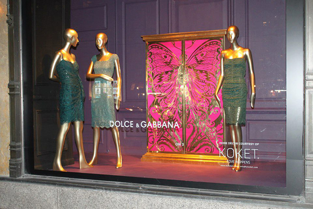 Mademoiselle butterfly fuchsia armoire by KOKET at Saks Fifth Avenue windows in New York.  KOKET furniture at Saks Fifth Avenue Saks Fifth Avenue window displays Koket armoire and Dolce Gabbana