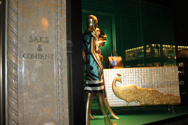 Camilia cabinet in mother-of-pearl and hand carved peacock in gold leaf by KOKET at Saks Fifth Avenue Windows.  KOKET furniture at Saks Fifth Avenue Saks Fifth Avenue window displays Koket collections