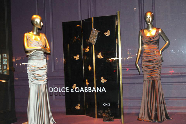 Euphoria folding screen by KOKET at Saks Fifth Avenue windows in New York.  KOKET furniture at Saks Fifth Avenue Saks Fifth Avenue window displays Koket screen and Dolce Gabbana