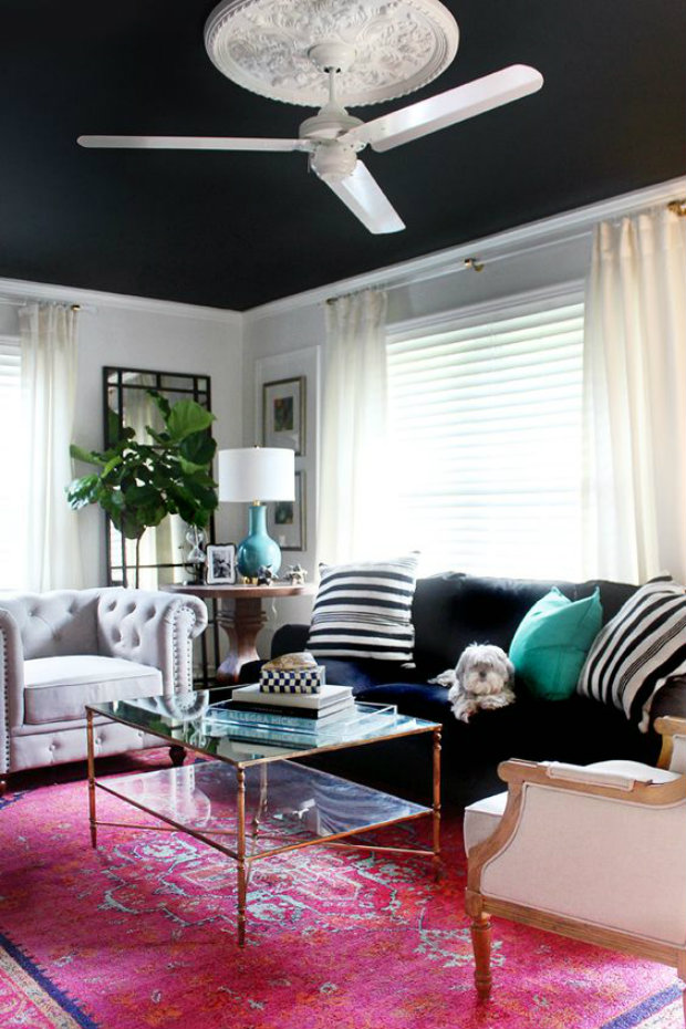 A black ceiling can open up a space with the illusion of removing the 5th wall.