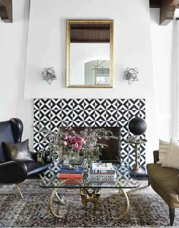 Stunning black and white tiled fireplace.