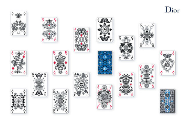 The pattern on the deck of cards was inspired by Christian Dior's personal gardens. Source: Elle Decor