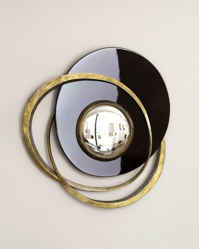 Known for his mixing of materials, Herve Van der Straeten's bold round mirror blends different finishes with a convex mirror. The result is not just a decorative mirror, but a piece of art.
