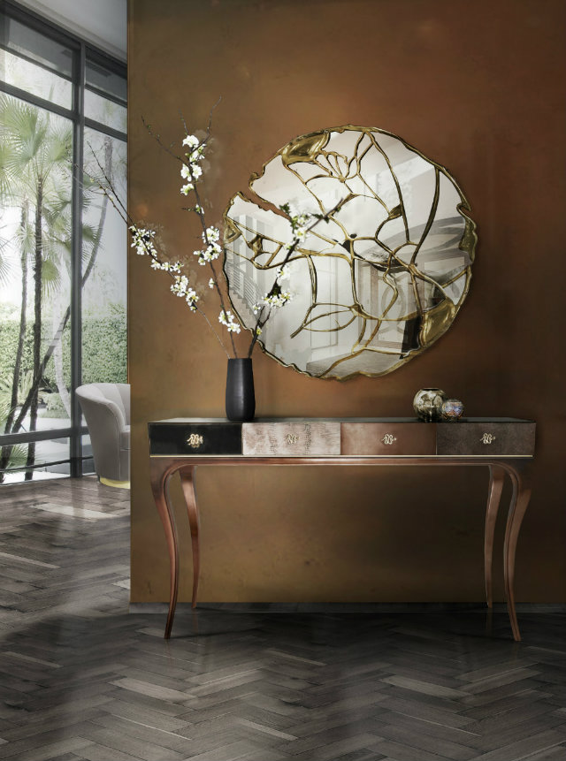 The Glance Mirror from Boca do Lobo contests traditional mirror design with mirror fragments pieced together with a fluid brass frame. This wall mirrors unique beauty is found in its daring design and ability to challenge the conventional.