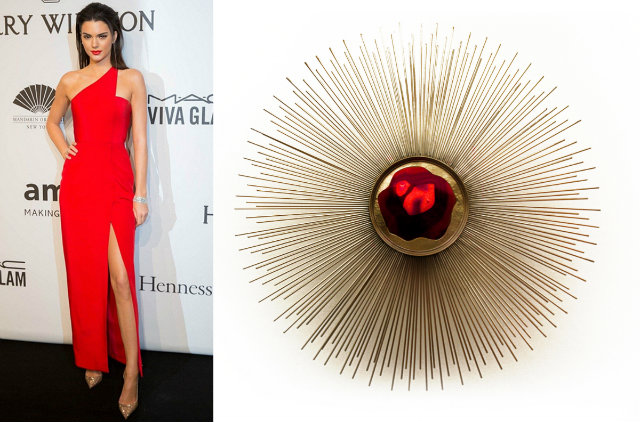 Jenner at the amfAR Gala in a vibrant red gown and the Brilliance sconce.