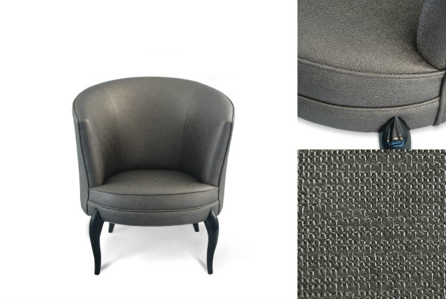 The Delice chair by KOKET is adorned in a Shades On colored, textured synthetic leather.