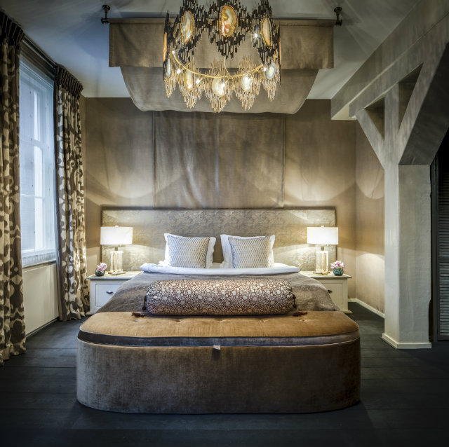 Bedroom of an Amsterdam canal house project featuring the Vivre chandelier.