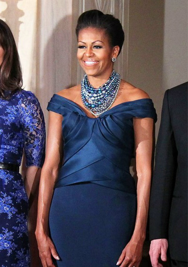 Michelle in 2012 in a blue off-the-shoulder gown by Marchesa.