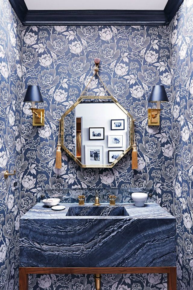 Combine two home design trends in one with statement floral wallpaper on an accent wall.