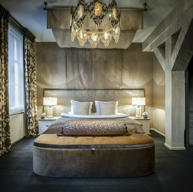 The Vivre Chandelier designed with natural agate slices hangs in a client's bedroom.