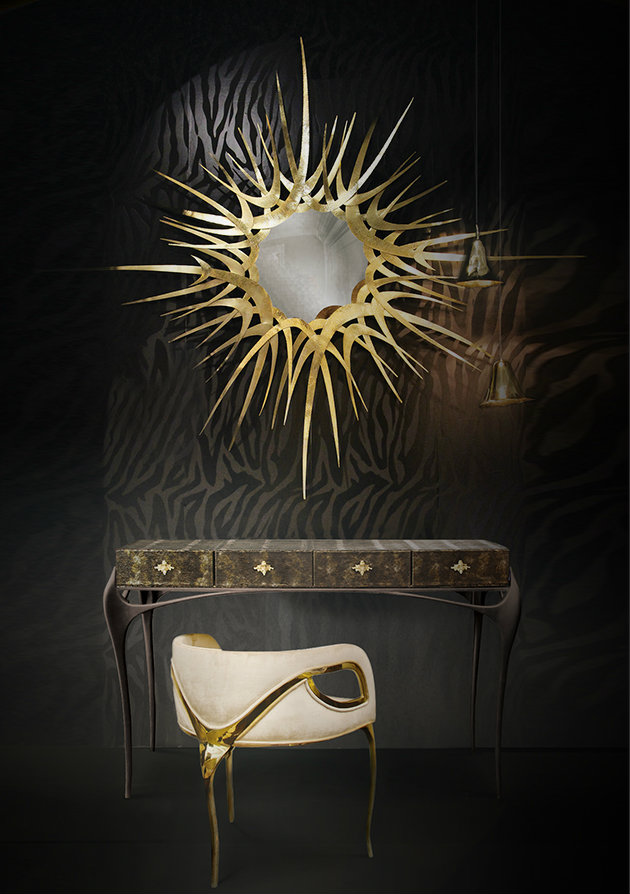 Add a touch of glamour to dark interiors by adding metallic accents for some shine. This KOKET project features the Chandra chair, Guilt mirror, Gia pendant and Temptation console.  dark interiors 10 Deliciously Dark Interiors 10 Deliciously Dark Interiors koket