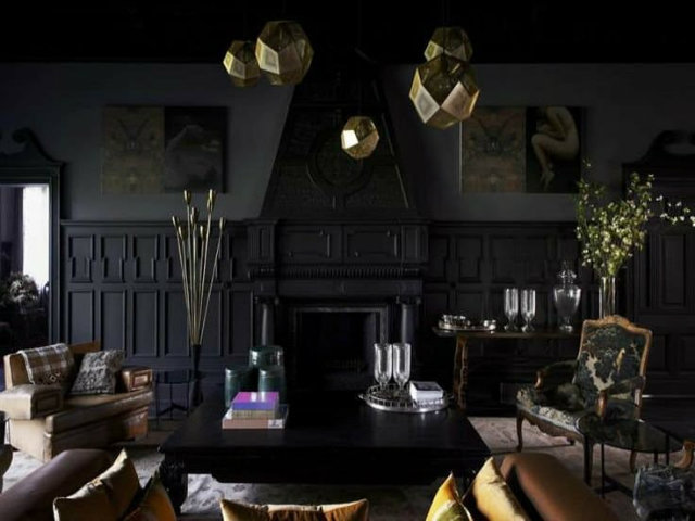The living room of this stunning Melbourne mansion highlights the architectural aspects of the space like the fireplace and paneling, by painting it a darker color than the walls.  dark interiors 10 Deliciously Dark Interiors 10 Deliciously Dark Interiors melbourne