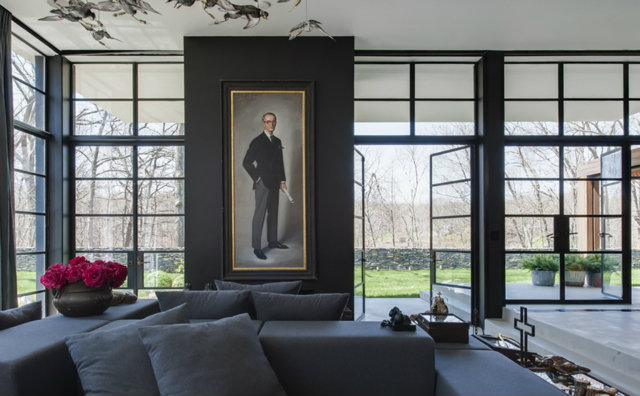 This dark interior by P&T Interiors features plenty of natural light that still gives it an airy feel. The mix of modern furnishings with traditional accents, like the portrait, give it a welcoming feel.  dark interiors 10 Deliciously Dark Interiors 10 Deliciously Dark Interiors pt