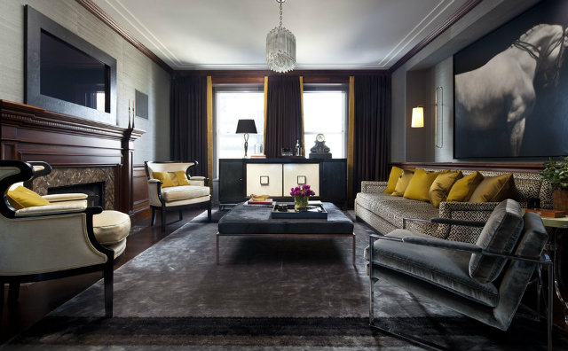 A pop of gold color in this dark living room by Summer Thornton Design Inc adds warmth and comfort to the space.  dark interiors 10 Deliciously Dark Interiors 10 Deliciously Dark Interiors summer