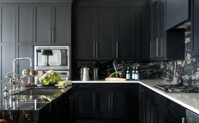 Dark kitchens are trending like this one from Beth Webb Interiors. The marble counters and backsplash create contrast and add a nice natural pattern to the space.  dark interiors 10 Deliciously Dark Interiors 10 Deliciously Dark Interiors webb