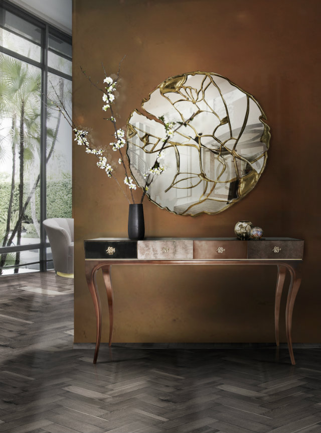 Chic yet impressionable, the entryway of this tropical home features the Untamed console by KOKET accompanied by the Glance mirror from Boca do Lobo.