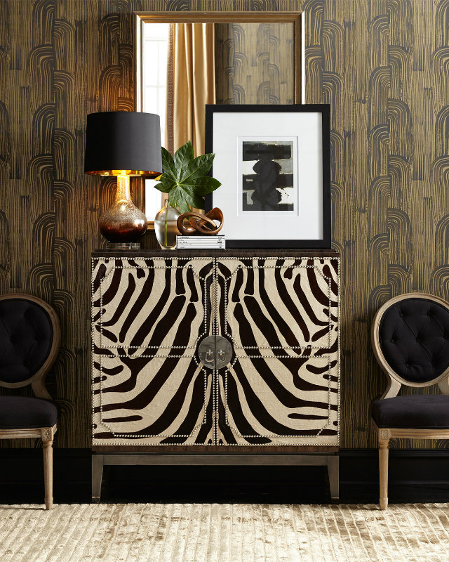 This entryway is elegantly reminiscent of the African safari with the hide paneled cabinet in zebra print, and the vintage wood-patterned wallpaper.