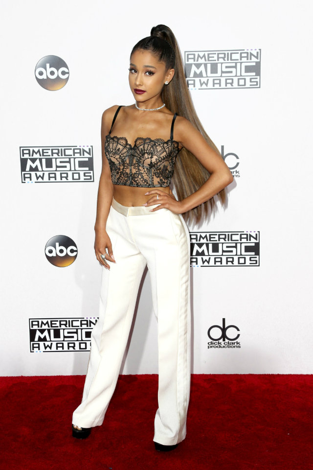 Ariana Grande looked modern and sexy on the red carpet in a lace crop top paired with a white wide-leg pant.