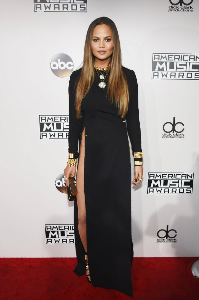 Chrissy Teigen showed off her amazing long legs in a black floor length dress with an above-the-thigh slit.