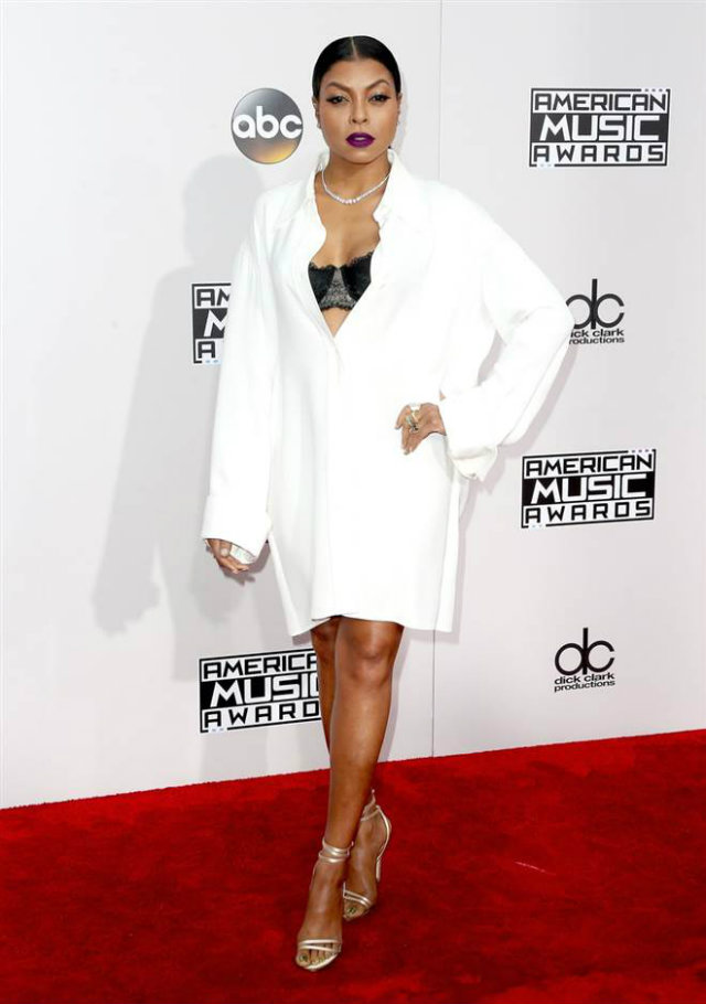 "Taraji P. Henson channels the ""boyfriend"" look effortlessly in a crisp white Celine button-down shirt, a lacy black bra and gold Jimmy Choo strappy sandals."