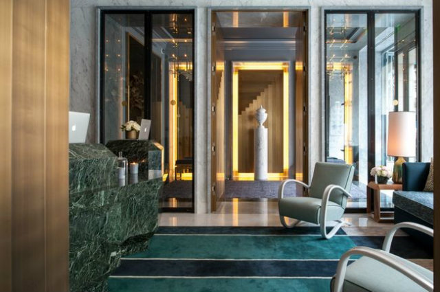 Guests are greeted at the entryway of the Nolinski Paris with a sleek emerald Carrara marble covered reception nolinski paris Enter the Jean-Louis Deniot Designed Nolinski Paris Hotel Enter the Jean Louis Denoit Designed Nolinski Paris Hotel