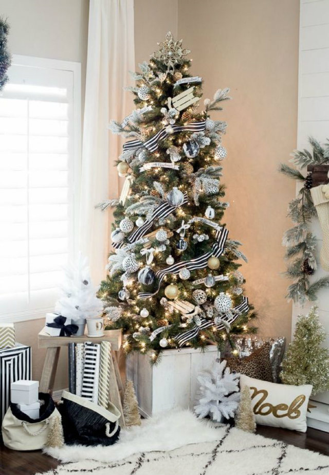Don't let space size hinder you from Christmas decorating. Smaller Christmas trees like this one look just as glamourous as floor to ceiling trees.