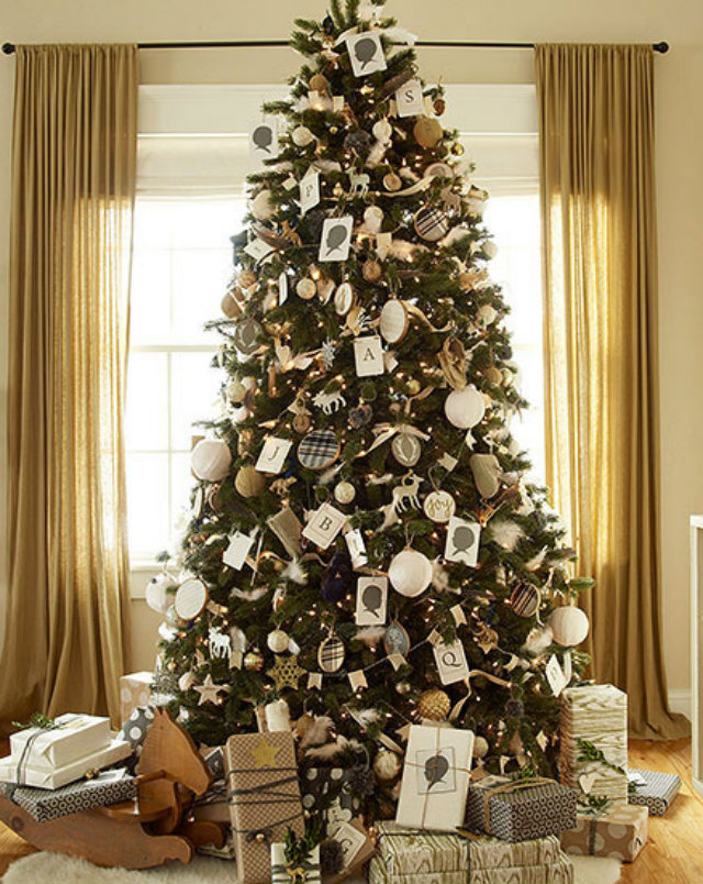 This Unique Tree Decoration Features Vintage Portrait And Alphabet Cards Mixed In With Various Holiday Ornaments