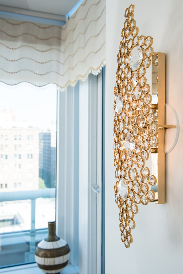 Eternity Sconce in Luxury Apartment in NYC by Perianth Interior Design luxury apartment Metallic Accents in a Neutral Setting Make a Stunning Luxury Apartment 2373 broadway detail perianth 161018 0012