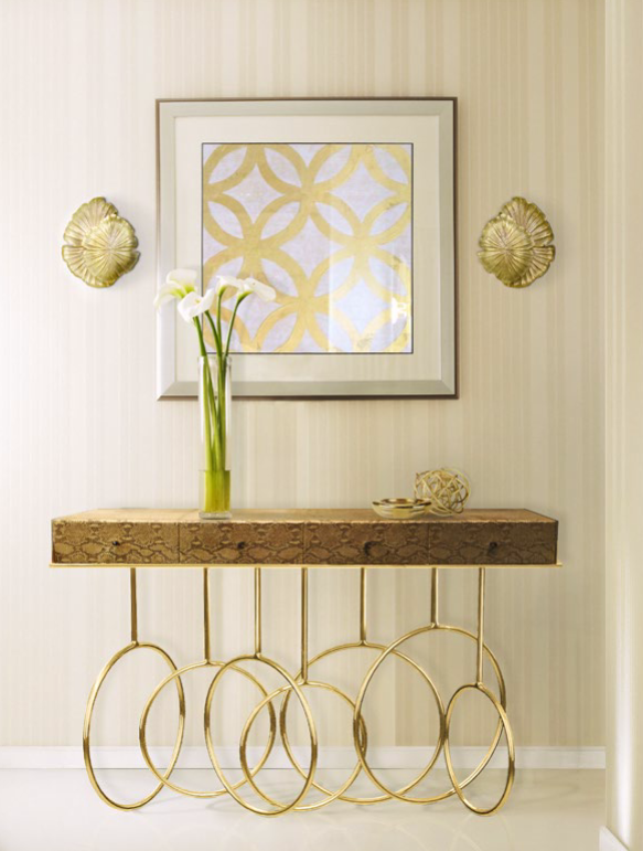 Light and Airy Foyer Design by KOKET - animal print console table - sculptural brass console table - foyer table - brass floral sconces - flower sconces - snakeskin foyer table - luxury furniture foyer design Looking for a Foyer Design That Will Dazzle and Delight? 3