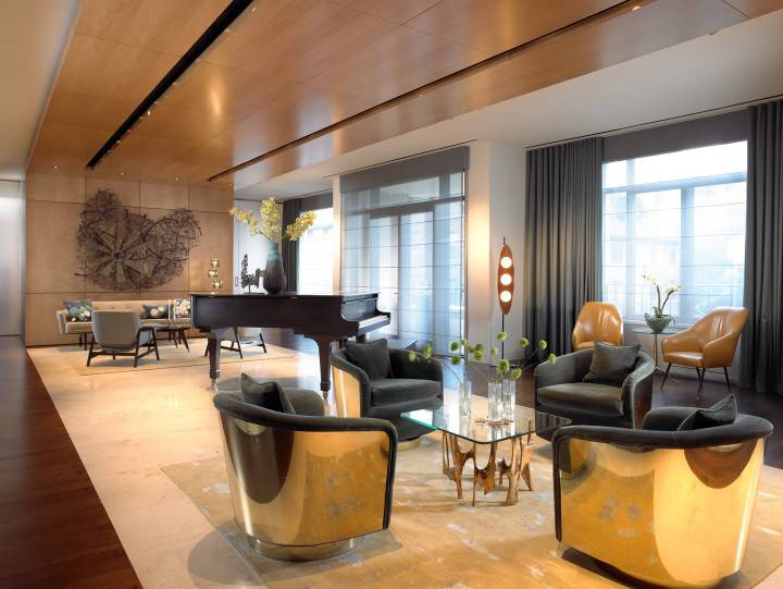 Top NYC Interior Designers - Amy Lau Design - Chicago Residence - Living Room Design - Glamorous Living Room - Luxury Furniture - Polished brass accent chairs