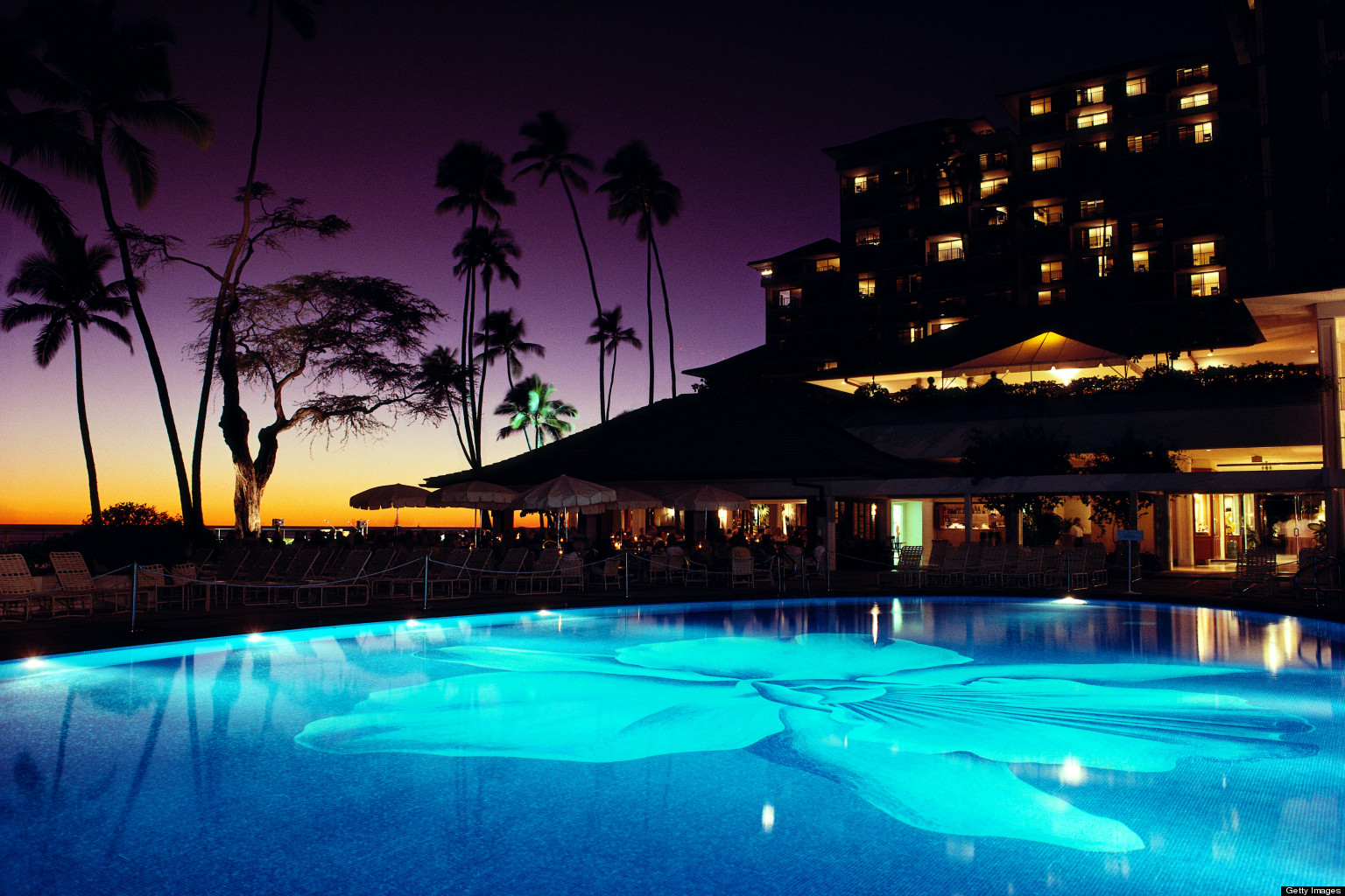 Top Luxury Hotels in America - Halekulani - Waikiki, HI - hi oahu, waikiki, halekulani hotel, lit pool at twilight exterior architecture Top Luxury Hotels in America Top Luxury Hotels in America for the Perfect End of Summer Getaway Halekulani Waikiki HI 2
