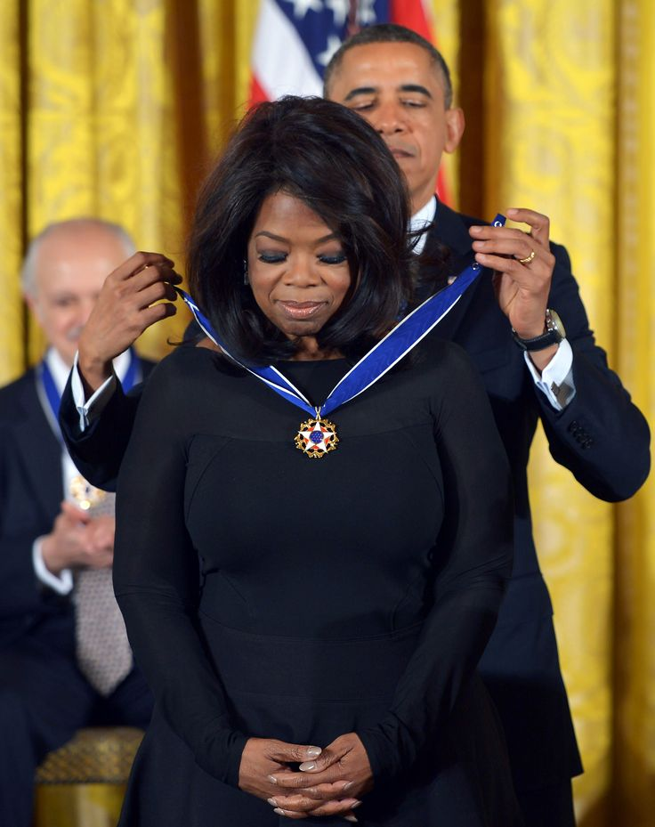 Women Empowerment - November 20, 2013: President Barack Obama presents Oprah Winfrey with the Presidential Medal of Freedom during a ceremony in the East Room of the White House in Washington, D.C. The Medal of Freedom is the country's foremost civilian honor