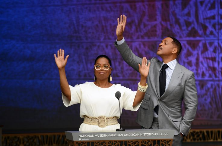Women Empowerment - September 24, 2016: Oprah Winfrey and actor Will Smith greet the crowd before quoting poems of famous African American poets during the dedication of the National Museum of African American History and Culture in Washington, D.C., before the museum opens to the public later that day. The museum is a Smithsonian Institution museum located on the National Mall featuring African American history and culture in the United States. (Astrid Riecken/Getty Images)