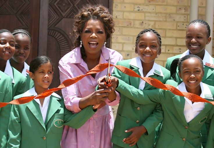 Women Empowerment - 02 Jan 2007, Henley-on-Klip, South Africa --- US talk show host Oprah Winfrey (C) cuts the ribbon with some of the girls who have enrolled in her school during the opening of the school funded by Winfrey in Henley-on-Klip, South Africa, Tuesday 02 January 2007. Some of the guests who attended the opening where, Chris Rock, Mariah Carey and Mary J Blidge. --- Image by © Kim Ludbrook/epa/Corbis