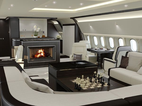 Luxury Private Jet Interior Design by Jet Aviation - Black and white jet interior - jet with a fireplace - airplane fireplace - Timeless concept
