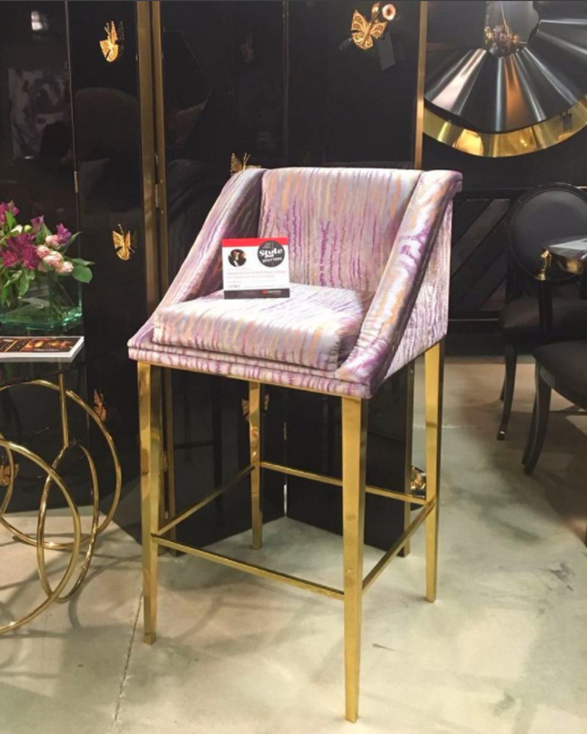 Geisha Bar Stool by KOKET - Fall 207 High Point Market Style Spotters Woodson & Rummerfield's House of Design, Ron Woodson and Jaime Rummerfield - Interior Design Trends 2018 - Gold metal and upholstered bar stool - square bar stool with back - KOKET Textiles Collection