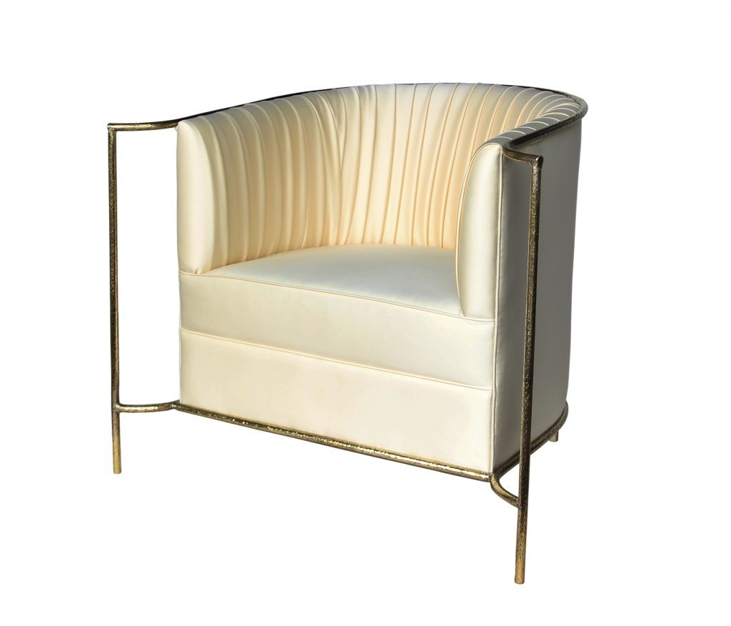 The Desire Chair in cream by KOKET. Photography by KOKET. Sexy chair. Cream and gold metal lounge chair. Hollywood glam chairs