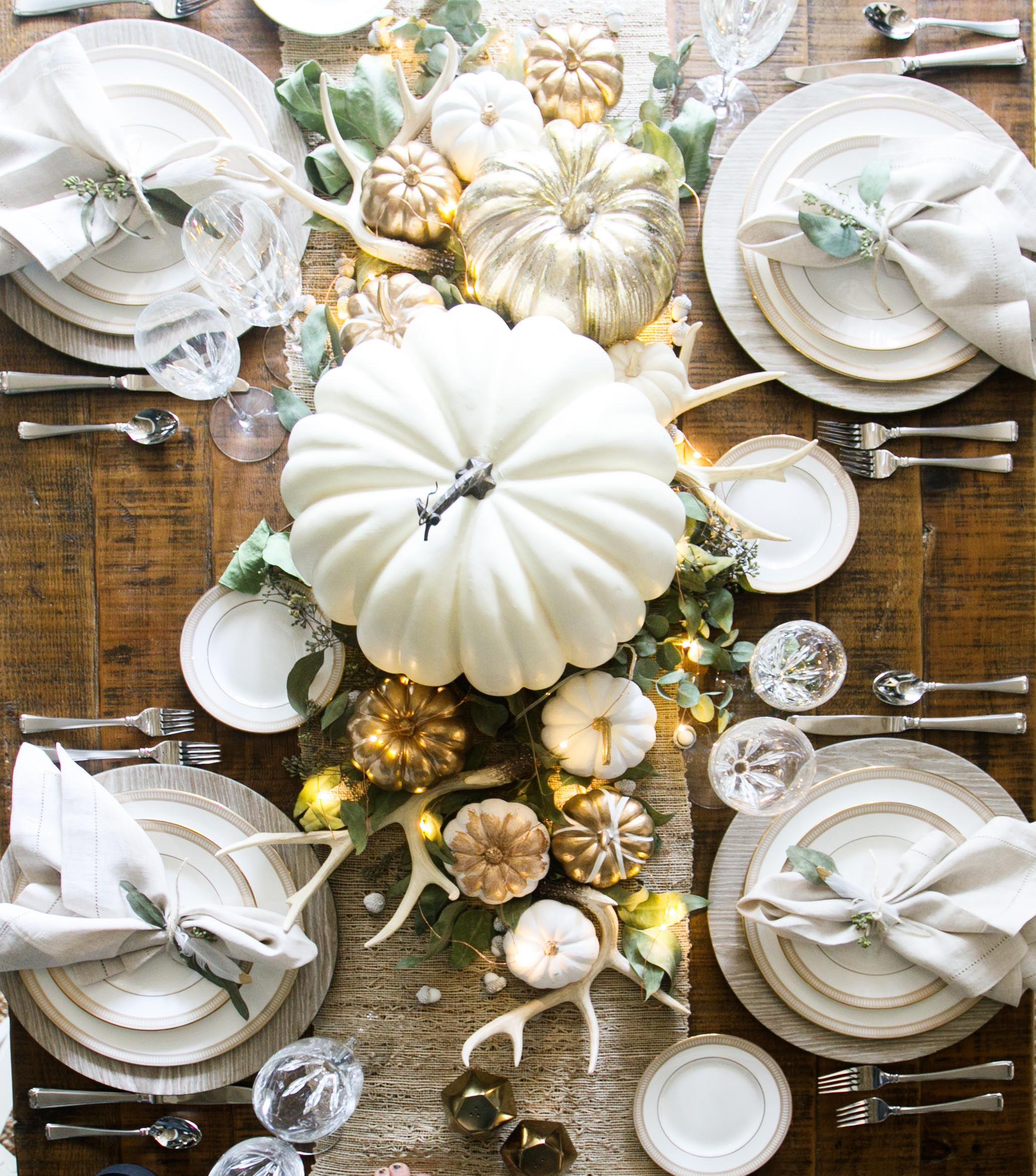 luxurious thanksgiving tablescapes white luxury rustic table distressed wood antlers busy decor warm tones white gold table setting thanksgiving 2017 holidays