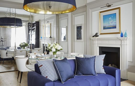 Taylor Howes Lowndes Street, Knightsbridge Top Interior Designers in London - Best interior designers in London - Best interior designers in europe - dining room design ideas - mirrored walls - glamorous chandeliers - fireplace design ideas