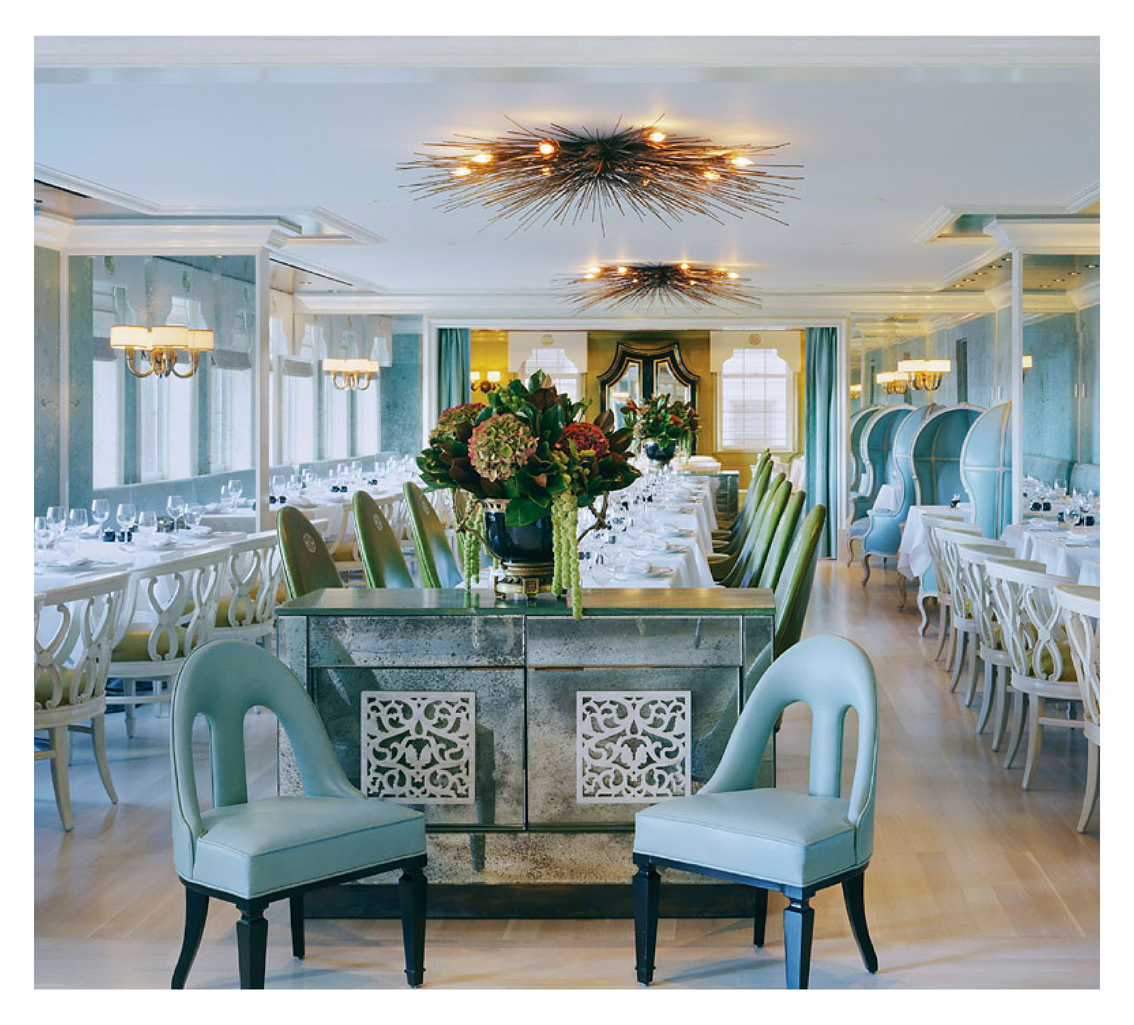 Top Interior Designers: Kelly Wearstler - blue interior design - dining room interiors - commercial interiors - cool color interior design - robins egg blue chairs