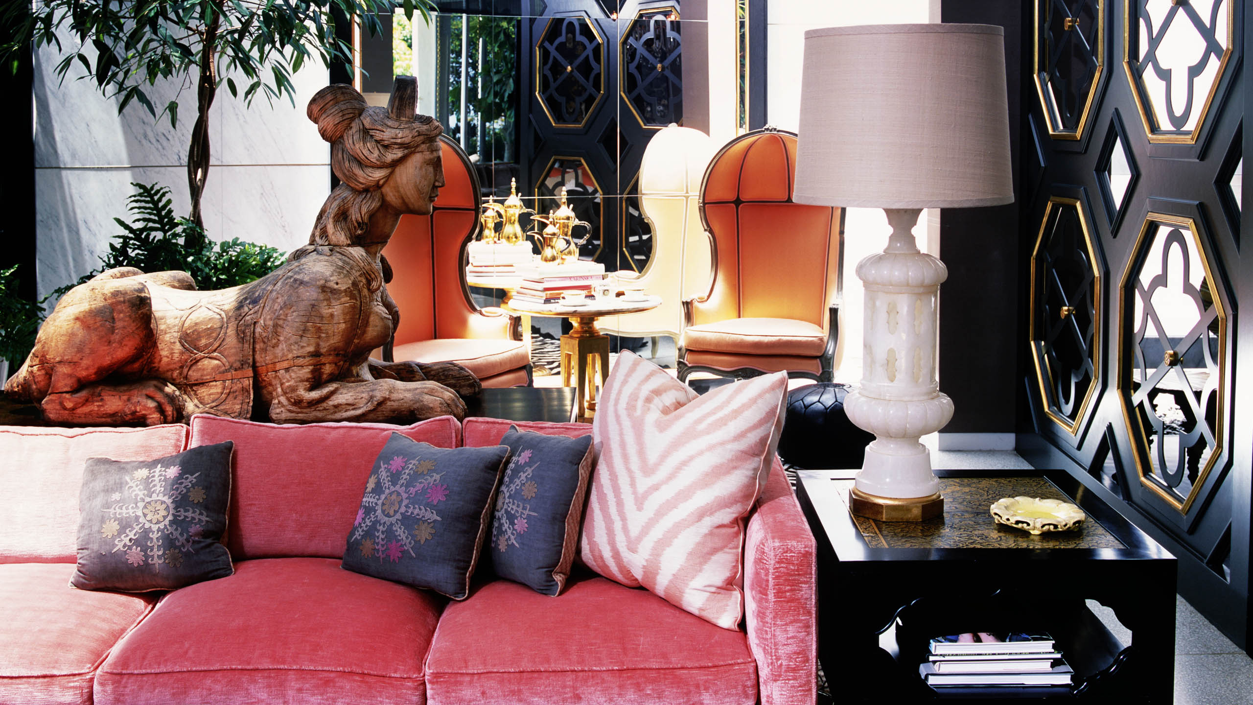Top Interior Designers: Kelly Wearstler - pink and gold decor - black interior design - lamp - warm colors - statue